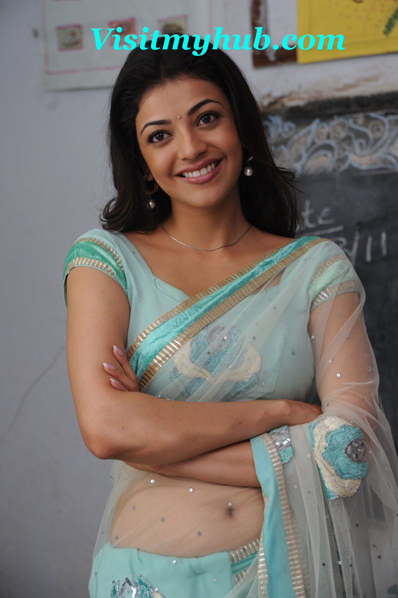 Kajal Agarwal Smiling beautiful sexy Navel show in Blue Transparent